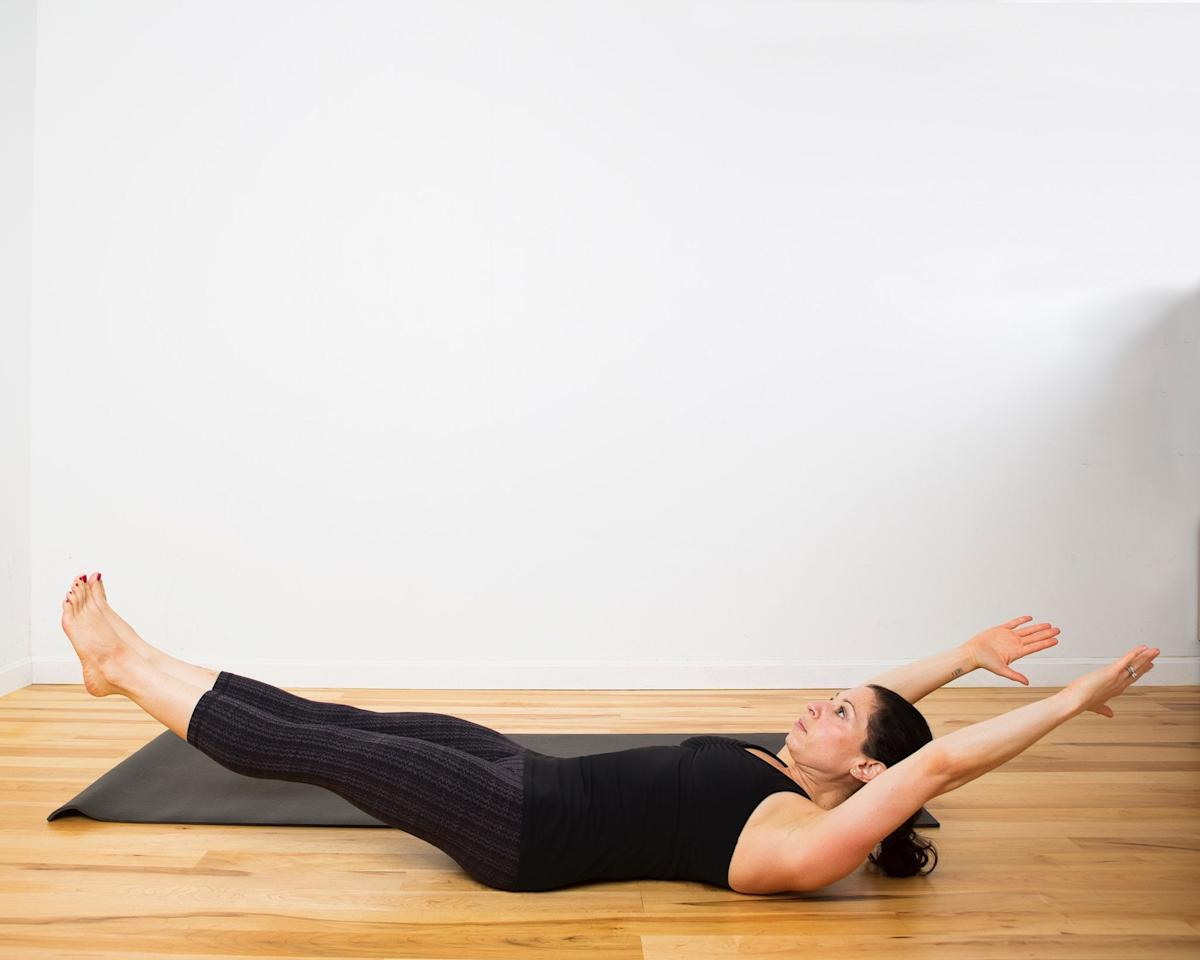 <ul> <li>Begin on your back with your legs straight and your arms extended overhead.</li> <li>Actively press your lower back into the floor and draw your belly button into your spine.</li> <li>Inhale to slowly lift your shoulders, arms, and legs off the floor. Keep your hands and heels as low to the ground as possible, while still pressing your lower back into the floor. Maintain tight abs and glutes. It's OK to bend your knees if straight legs are too challenging.</li> <li>Hold like this for 30-60 seconds.</li> </ul>