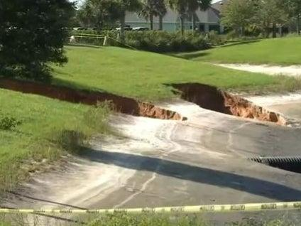 Two of three sinkholes that opened up in The Villages in Florida on Monday. (screengrab)