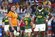 Rival captains Australia's Michael Hooper, left, and South Africa's Siya Kolisi react during the Rugby Championship test match between the Springboks and the Wallabies in Brisbane, Australia, Saturday, Sept. 18, 2021. (AP Photo/Tertius Pickard)