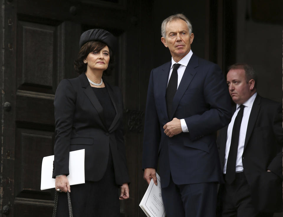 FILE - In this April 17, 2013 file photo former British Prime Minister Tony Blair and his wife Cherie Blair leave the ceremonial funeral of former British Prime Minister Baroness Thatcher in St Paul's Cathedral in London. Hundreds of world leaders, powerful politicians, billionaires, celebrities, religious leaders and drug dealers have been stashing away their investments in mansions, exclusive beachfront property, yachts and other assets for the past quarter century, according to a review of nearly 12 million files obtained from 14 different firms located around the world. The report released Sunday, Oct. 3, 2021, by the International Consortium of Investigative Journalists involved 600 journalists from 150 media outlets in 117 countries. Former British Prime Minister Tony Blair is one of 330 current and former politicians identified as beneficiaries of the secret accounts. (AP Photo/Chris Jackson, Pool, File)