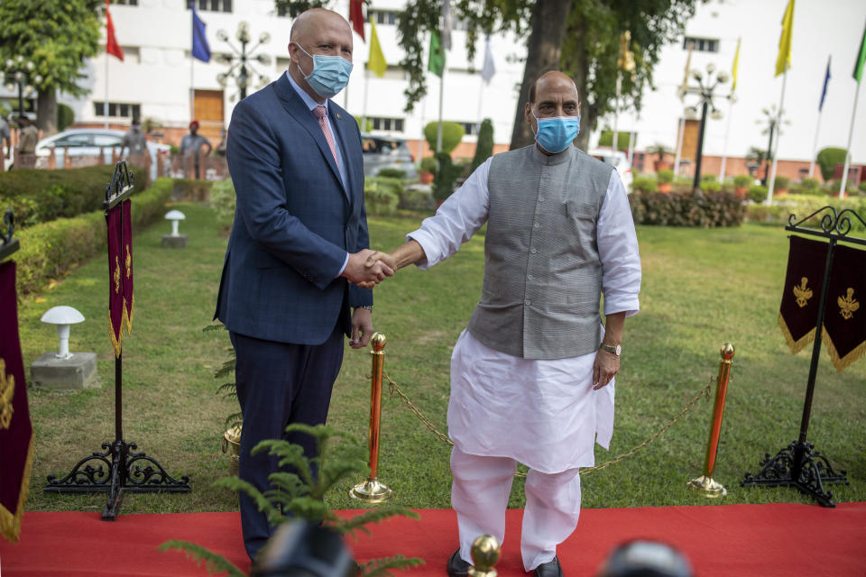 Australian Defense Minister Peter Dutton, left, and his Indian counterpart Rajnath Singh shake hands during a Guard of Honor for the former in New Delhi, India, Friday, Sept. 10, 2021. India on Friday sought investment from Australia's defense industry as the two countries discussed steps to bolster defense ties and cooperation on maritime security in the Indo-Pacific region with China flexing its muscles in the region. (AP Photo/Altaf Qadri)