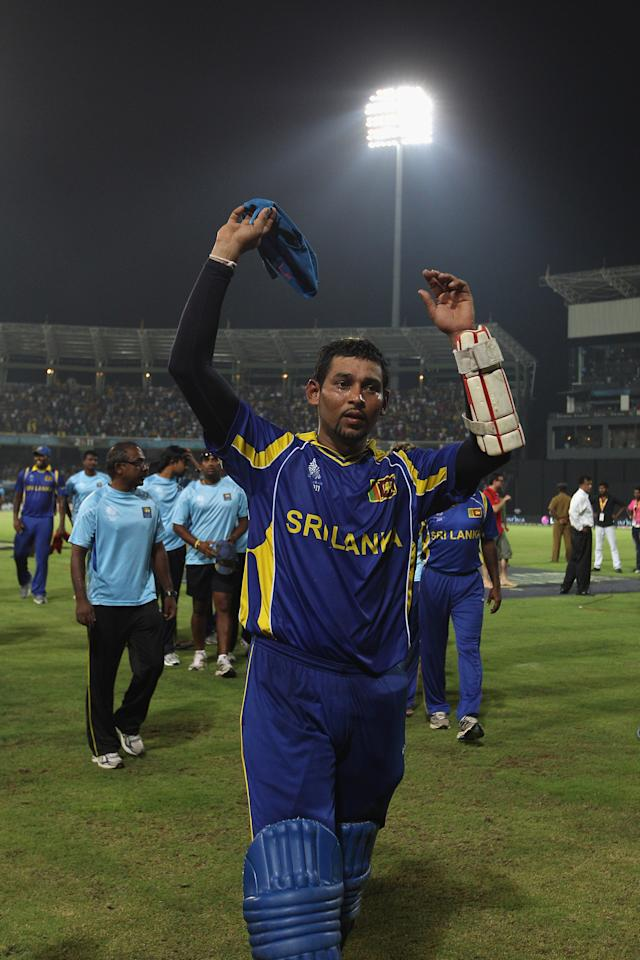 COLOMBO, SRI LANKA - MARCH 26: Tillakaratne Dilshan of Sri Lanka acknowledges the home support after his century and ten wicket victory after Sri Lanka's ten wicket victory during the 2011 ICC World Cup Quarter-Final match between Sri Lanka and England at R. Premadasa Stadium on March 26, 2011 in Colombo, Sri Lanka.  (Photo by Michael Steele/Getty Images)