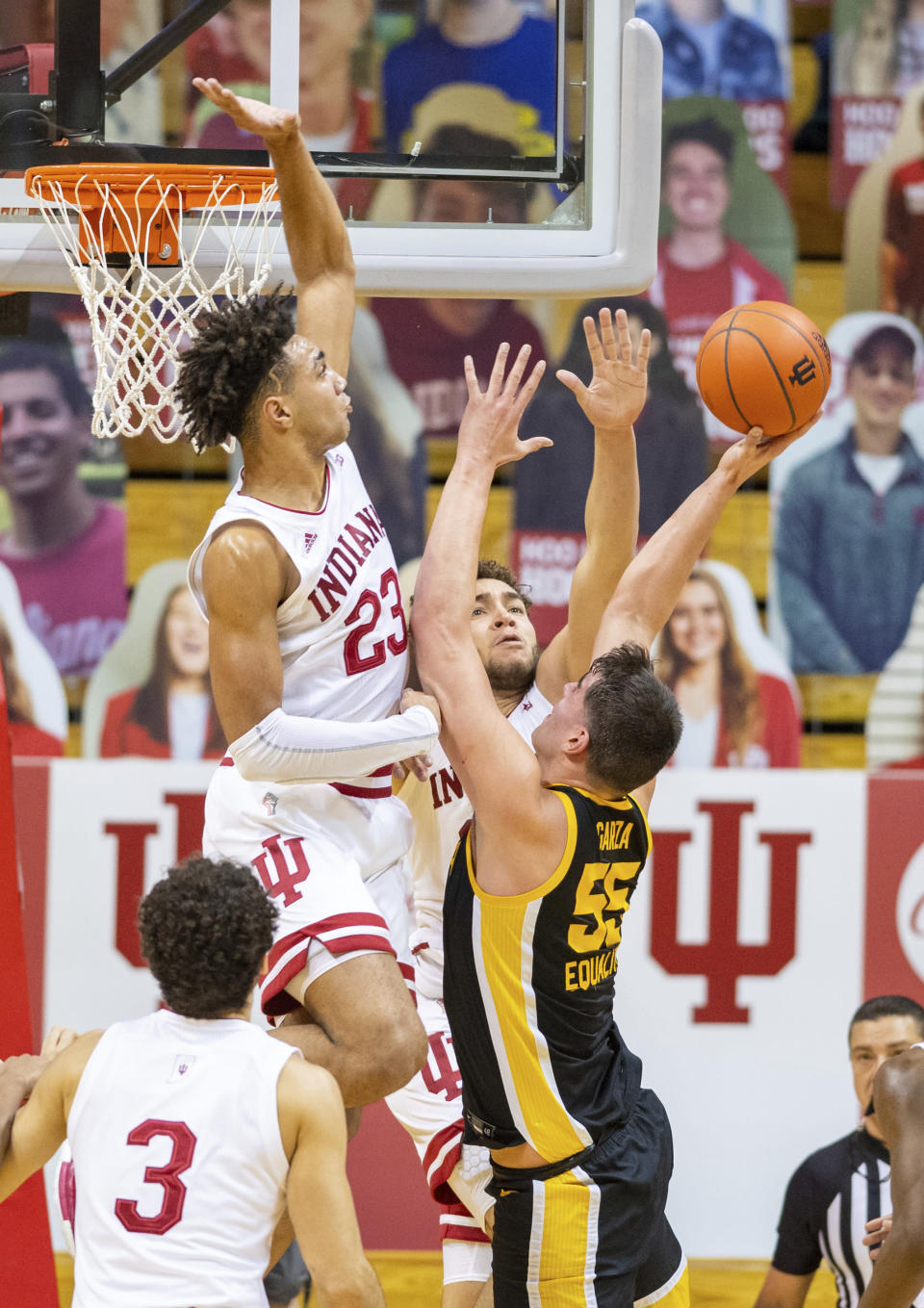 Indiana forward Trayce Jackson-Davis (23) goes up to block a shot by Iowa center Luka Garza (55) during the second half of an NCAA college basketball game, Sunday, Feb. 7, 2021, in Bloomington, Ind. (AP Photo/Doug McSchooler)