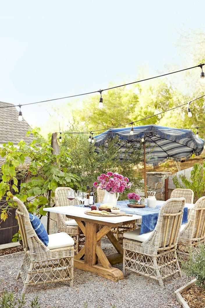 """<p>Cafe-style lights make this bucolic California backyard feel like the charming French countryside.</p><p><a class=""""link rapid-noclick-resp"""" href=""""https://www.amazon.com/Amico-Commercial-Weatherproof-Incandescent-Heavy-Duty/dp/B07CJNTJL1/?tag=syn-yahoo-20&ascsubtag=%5Bartid%7C10050.g.3404%5Bsrc%7Cyahoo-us"""" rel=""""nofollow noopener"""" target=""""_blank"""" data-ylk=""""slk:SHOP STRING LIGHTS"""">SHOP STRING LIGHTS</a></p>"""