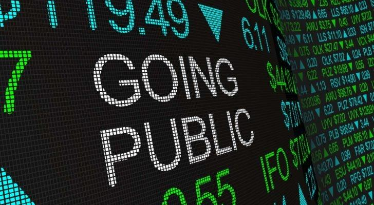 """""""Going Public"""" is displayed in white text on a digital ticker tape."""