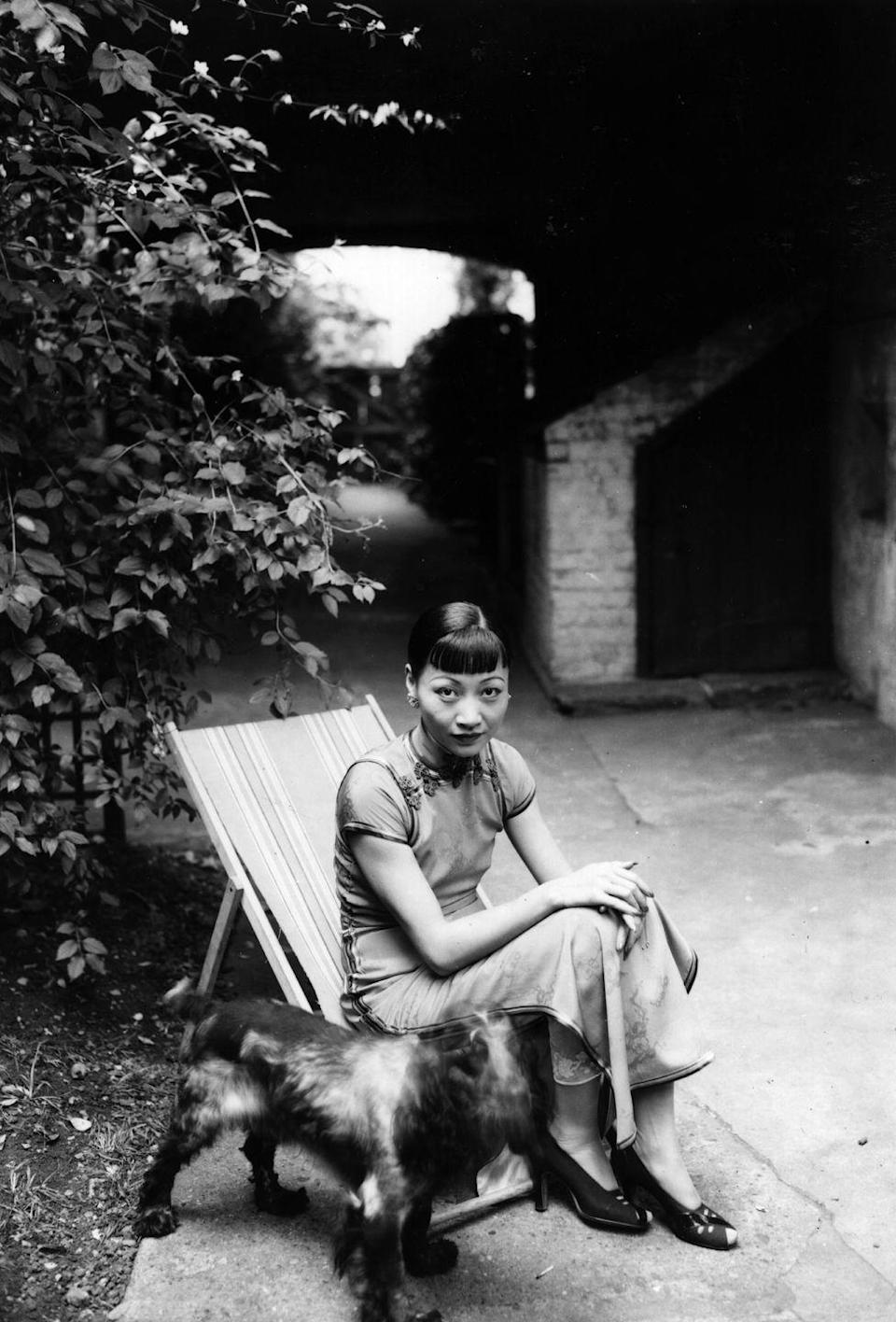 <p>In the same shoot, Wong was also photographed sitting outside with her dog. </p>
