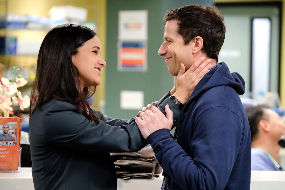 Amy Santiago (Melissa Fumero), left, and Jake Peralta (Andy Samberg) are now married police colleagues on NBC's 'Brooklyn Nine-Nine.'