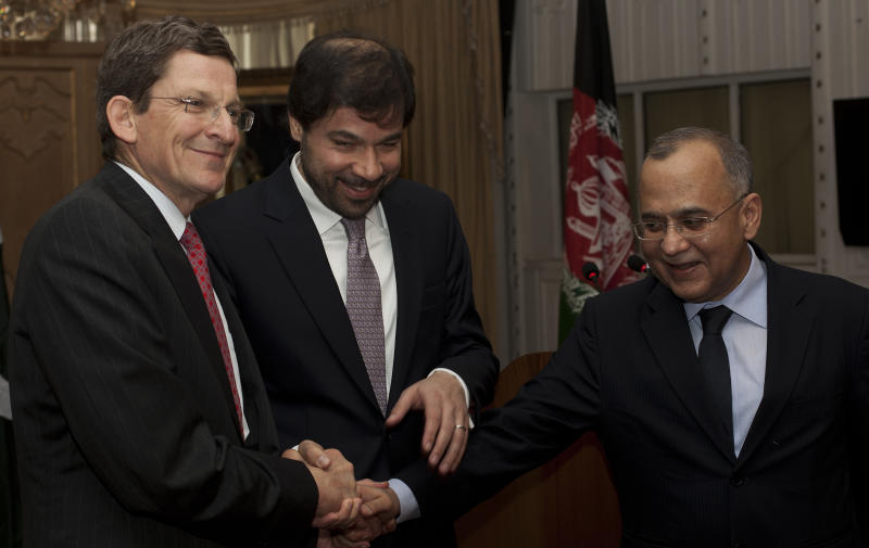 """Pakistan's Foreign Secretary Salman Bashir, right, joins hands with Afghanistan Deputy Foreign Minister Jaweed Ludin, center, and US Special Representative for Afghanistan and Pakistan Marc Grossman prior their joint news conference at the Foreign Office in Islamabad, Pakistan, on Tuesday, May 3, 2011.    A day after the death of al-Qaida leader Osama bin Laden in a U.S. led attack on a safe-house compound in Pakistan, Grossman met for a dialogue with Pakistani top officials. In response to questions from reporters, Grossman emphatically said """"Osama bin Laden is dead"""", calling the late al-Qaida leader an """"enemy"""" of the US, Pakistan and Afghanistan and saying that his death was a good thing. (AP Photo/B.K.Bangash)"""