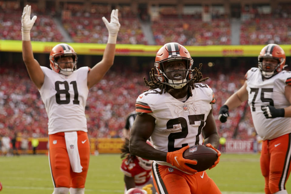 Cleveland Browns running back Kareem Hunt (27) scores as teammate Austin Hooper (81) celebrates during the second half of an NFL football game against the Kansas City Chiefs Sunday, Sept. 12, 2021, in Kansas City, Mo. (AP Photo/Charlie Riedel)