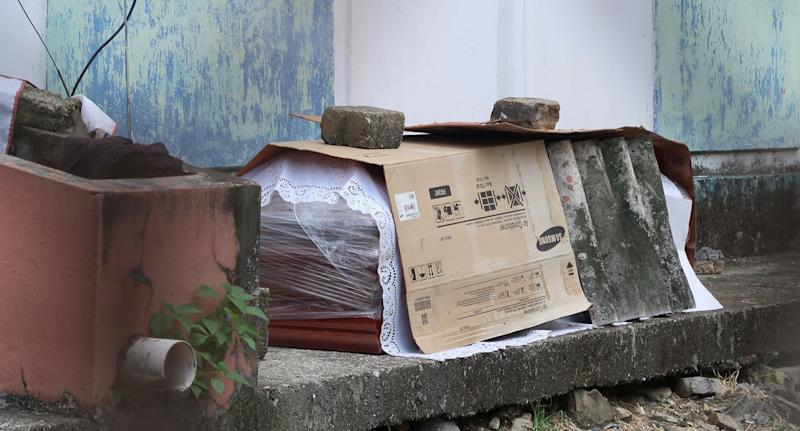 A coffin with a body inside on the street as residents in Guayaquil, Ecuador, battle coronavirus.