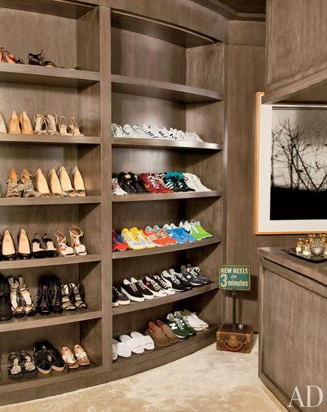 Comedian Ellen DeGeneres and actress Portia de Rossi stored their respective sneakers and high heels in the elegant closet of their Beverly Hills home , which was revamped by decorator Melinda Ritz. The shelving was constructed of stained walnut and the vintage sign was found at a flea market. (November 2011)