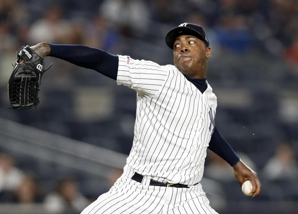 FILE - In this June 24, 2019, file photo, New York Yankees closer Aroldis Chapman winds up in the ninth inning of a baseball game against the Toronto Blue Jays in New York. Yankees manager Aaron Boone announced Saturday, July 11, 2020, that Chapman has tested positive for the coronavirus and is experiencing mild symptoms. (AP Photo/Kathy Willens, File)