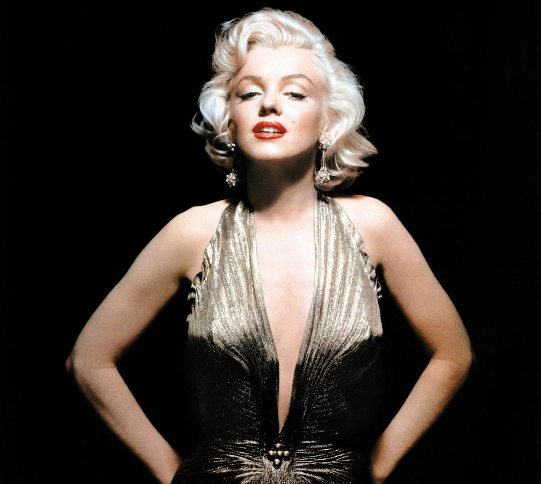 """In this undated publicity photo courtesy Running Press, Marilyn Monroe is shown wearing a knife-pleated gold lamé gown made from """"one complete circle of fabric."""" She wore this dress in """"Gentlemen Prefer Blondes."""" Monroe passed away a half-century ago this week, a murky death that remains one of Hollywood's most tantalizing mysteries. But look around: Her legend lives on, more vibrantly than ever. In a twist she surely would have appreciated, this 1950's bombshell has become a 21st-century pop culture phenom. (AP Photo/Courtesy Running Press)"""