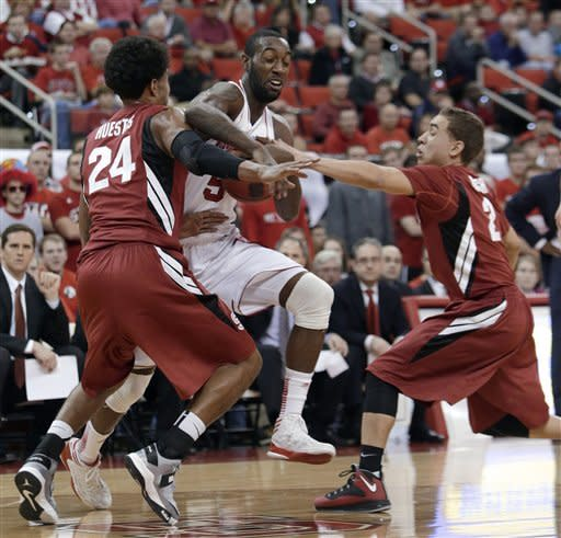 North Carolina State's C.J. Leslie, center, struggles for possession of the ball with Stanford's Josh Huestis (24) and Aaron Bright during the first half of an NCAA college basketball game in Raleigh, N.C., Tuesday, Dec. 18, 2012. (AP Photo/Gerry Broome)
