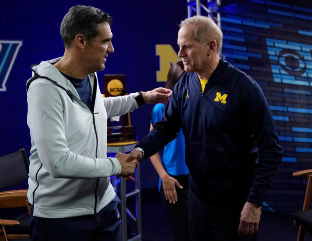 "Villanova head coach Jay Wright, left, and Michigan head coach John Beilein greet each other after an interview for CBS Sports Network's ""We Need to Talk"" show before the championship game of the Final Four NCAA college basketball tournament, Sunday, April 1, 2018, in San Antonio. (AP Photo/David J. Phillip)"