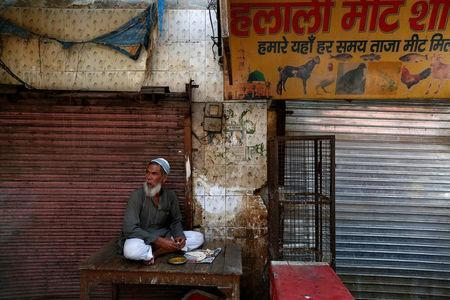 A muslim meat shop owner looks on outside his closed shop in Gurugram, Haryana, March 29, 2017. REUTERS/Cathal McNaughton