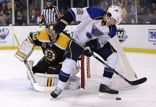 St. Louis Blues left wing Magnus Paajarvi (56) tries to center the puck in front of Boston Bruins goalie Tuukka Rask during the first period of an NHL hockey game, Thursday, Nov. 21, 2013, in Boston. (AP Photo/Charles Krupa)