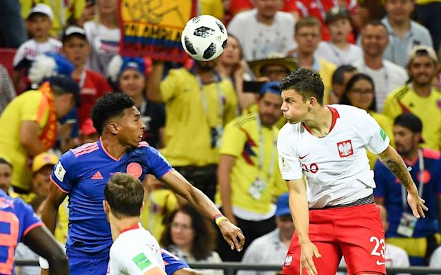 "7:24PM 23 mins - Poland 0 Colombia 0 After a couple of fouls in midfield, Colombia break again and Cuadrado tries to feed Quintero, but it doesn't come off. Poland recover and storm up the other end. They win a corner off Barrios, but it is cleared. End-to-end stuff, this! 7:21PM 21 mins - Poland 0 Colombia 0 Colombia break from the cleared throw in. Quintero plays an acute reverse through ball to Aguilar, but he isn't on the same page and it goes through to the keeper. 7:20PM 19 mins - Poland 0 Colombia 0 The ball is headed out for a throw in. Poland really piling on the pressure but haven't had a clear shot on goal yet. They win another throw in. It's Rory Delap territory....and Piszczek fancies himself as a Polish Delap... 7:18PM 18 mins - Poland 0 Colombia 0 Zelinski shoots from distance, but it is deflected out for a Poland Corner. Rybus to take. 7:18PM 17 mins - Poland 0 Colombia 0 Tottenham's Davison Sanchez takes down Lewandowski in the centre of the pitch. Ally McCoist says ""I want him yellow carded."" The referee doesn't listen, and just gives Sanchez a talking to. 7:16PM 15 mins - Poland 0 Colombia 0 Colombia break forward again and Mojica crosses to Rodriguez, but the Bayern Munich player can't quite connect with the volley. It goes out for a Poland throw in - the Colombian fans boo. 7:14PM 14 mins - Poland 0 Colombia 0 Poland certainly on top as far as this touch map shows. Most of the game being played in the Colombia half. Average touch positions (5 min) 7:11PM 10 mins - Poland 0 Colombia 0 Colombia win a throw in and the crowd go mad. These Colombian fans are making an incredible noise. They are booing every Poland attack. They are like human vuvuzelas, but far more tuneful. 7:09PM 8 mins - Poland 0 Colombia 0 Colombia have their first attack. Falcao and Rodriguez combine, but the shot is comfortable for Szczesny. It's a lively start in Kazan. 7:08PM 7 mins - Poland 0 Colombia 0 Yerry Mina has his hand trodden on by Robert Lewandowski. It looked painful, but not deliberate. 7:05PM 5 mins - Poland 0 Colombia 0 Pazdan goes down under a challenge and rolls around for a little bit. He's fine. Poland attack again and Bereszynski heads goalwards. Kownacki appears to trip David Ospina as he collects the ball and the medics have come on to the pitch. Ospina looks in discomfort. 7:03PM 2 mins - Poland 0 Colombia 0 Another Poland corner, this time played short, is intercepted at the near post. Mojica has taken a football to the nether regions and looks in pain. He'll carry on though... 7:02PM 1 min - Poland 0 Colombia 0 Early pressure from Poland sees them win a corner. The ball flies through everyone and eventually is cleared by James Rodriguez. It is noisy in Kazan. The Colombia fans are on great form. 7:01PM Kick Off It's 9pm in Kazan and still 27 degrees. Colombia will be used to this, but Poland may be used to colder climes. Poland, playing in white shirts and red shorts are kicking right to left, against an all-blue Colombia. 6:57PM It's anthem time Seven nation army plays the two teams out. No 'Oh Jeremy Corbyn' in Kazan. Poland sing first, with the Mazurek Dąbrowskiego. Colombia, meanwhile belt out the Himno Nacional de la República de Colombia. 6:41PM Those teams again... Poland look to be playing a 3-4-3 formation, while Colombia are playing 4 at the back, two defensive midfielders, three attackers and Falcao at the top. (Or 4-2-3-1). 20 minutes to go... The match is live on ITV, but I recommend you stay up to date with the game here. You can tweet me directly @jamieojohnson Meanwhile, in Kazan... The teams are confirmed for #POLCOL! #WorldCuppic.twitter.com/dfEqnWm3ei— FIFA World Cup �� (@FIFAWorldCup) June 24, 2018 6:29PM Colombia are winning the World Cup of headgear So says our man in Kazan, Jim White has been taking snaps of Colomian fans' headgear. The good, the bad and the Irish. Mohawk for this man Credit: Jim White I feel sorry for the person sat behind this chap Credit: Jim White Luck of the Irish for Colombia today? Credit: Jim White This is just downright scary Credit: Jim White 6:16PM Four changes for both sides For Colombia, Yerry Mina has come in for Oscar Murillo in the centre of defence, meanwhile Aguilar, Barrios and James start in midfield. Sanchez, who was red carded against Japan is suspended, and Lerma and Izquierdo have been dropped. For Poland, Bednarek comes into central defence, replacing Cionek, and Bereszynski, Goralski and Kownacki, also start, in place of Blaszczykowski, Milik and Grosicki. 6:06PM The teams are in! Poland XI: Szczesny, Pizsczek, Bednarek, Pazdan, Bereszynski, Goralski, Krychowiak, Rybus, Zielinski, Kownacki, Lewandowski Colombia XI: Ospina, Arias, D. Sanchez, Mina, Mojica, Aguilar, Barrios, Cuadrado, James, Quintero, Falcao 5:58PM Harry Kane looks happy Nothing to do with Poland vs Colombia, but Harry Kane looks chuffed. We're going to win the World Cup. Love this team. Proud of a first World Cup hat-trick. We keep going. ��⚽⚽⚽ #WorldCup#ThreeLions ������ pic.twitter.com/c3UDUqL9EN— Harry Kane (@HKane) June 24, 2018 5:51PM It's all over between Senegal and Japan 2-2 it has finished, throwing this group wide open. Both of them have 4 points, while Colombia and Poland start today both on 0. If either team wins tonight, the other will be out. And lets not forget why this matters... England will play either the first or second placed team in this group, so time to start taking notes. 5:45PM Falcao is up for this one The Colombian forward has tweeted a video in which he says he wants to turn defeat into victory. Kindly, the words are also written in English. Muchas gracias, Radamel. Podemos hacerlo. Que el aliento de millones de colombianos llegue hasta el estadio. ¡Vamos Colombia! ¡Vamos que se puede! #ConLaFeIntacta#Colpic.twitter.com/h7EEgT3FFn— Radamel Falcao (@FALCAO) June 24, 2018 5:37PM Good afternoon, football fans. Well goodness me, what a game we've had today. Senegal and Japan are drawing 2-2 - and there's still 10 minutes to go! The 1 o'clock kick-off was pretty good too. But we're here for Poland versus Colombia - a tie that should have been a top-of-the-group clash, but after shock first round results, both teams are fighting for their World Cup lives. So if you're having a beer-induced afternoon snooze, this is worth waking up for. Poland haven't been to the World Cup since 2006, and looked nervous against Senegal. For 85 minutes they didn't particularly engage in the game and frontman Robert Lewandowski just couldn't get into the game. Poland are ranked the 8th best team in the world by Fifa (Colombia are 16th) so today they must step up and justify that ranking. In Colombia's loss to Japan, disaster struck after just three minutes, when Carlos Sanchez Moreno was sent off for a hand ball. Despite drawing level, they could not see a way through and lost 2-1. James Rodriguez, the World Cup golden boot winner in 2014 started on the bench, as did AC Milan striker Carlos Bacca and Barcelona defender Yerry Mina. Rodriguez should start today. Colombia's 'problem' is akin to that of Argentina. They have a lot of firepower, but not a lot of balance. Juan Cuadrado, Radamel Falcao, Carlos Bacca and James Rodriguez can all tear teams apart on their day, but haven't performed well enough so far. The match kicks off at 7pm and will take place in the Kazan Arena. Teams news and updates to follow shortly. For now, why not follow the action in the other Group H game here."