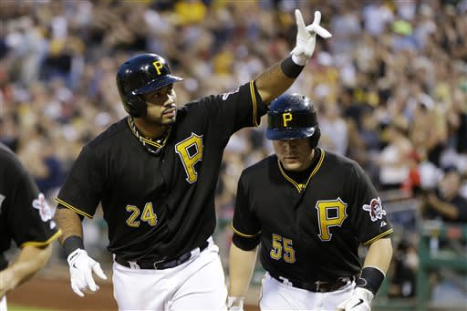 Pittsburgh Pirates' Pedro Alvarez (24) celebrates as he returns to the dugout with teammate Russell Martin (55) who also scored on his three-run home run off Philadelphia Phillies starting pitcher John Lannan during the fifth inning of a baseball game in Pittsburgh, Wednesday, July 3, 2013. (AP Photo/Gene J. Puskar)