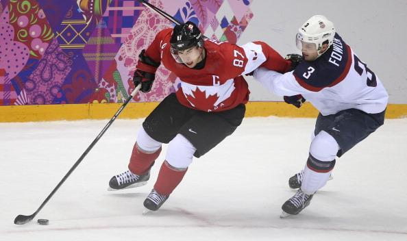 Canada's Sidney Crosby makes a move around Cam Fowler. At the Winter Olympics in Sochi, Canada's men's hockey team beat team USA 1-0 in semi-final action at the Bolshoy ice palace. Canada now moves on to the gold medal round against Sweden. February 21, 2014 (Getty Images)