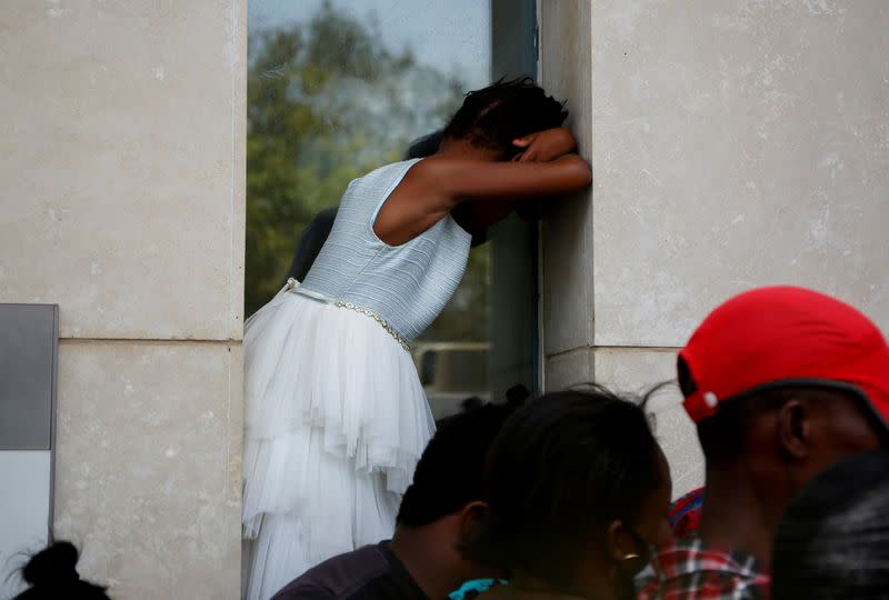 FILE PHOTO: Haitians gather outside the U.S. Embassy after the assassination of President Jovenel Moise, in Port-au-Prince