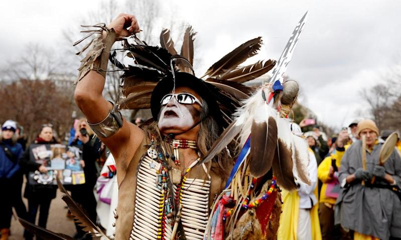 Little Thunder, a traditional dancer and indigenous activist from the Lakota tribe, dances as he demonstrates in front of the White House.