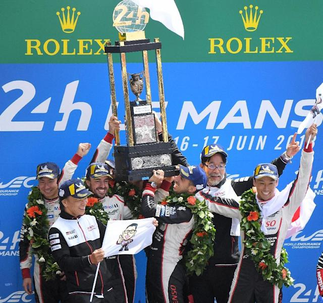 The six drivers from the two Toyota cars celebrated together after finishing first and second at Le Mans (AFP Photo/LOIC VENANCE)
