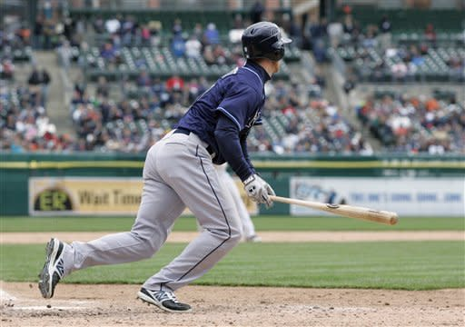 Tampa Bay Rays' Ben Zobrist watches his game-winning single that drove in teammates Carlos Pena and Evan Longoria in that ninth inning to defeat the Detroit Tigers 4-2 in a baseball game on Wednesday, April 11, 2012, in Detroit. (AP Photo/Duane Burleson)