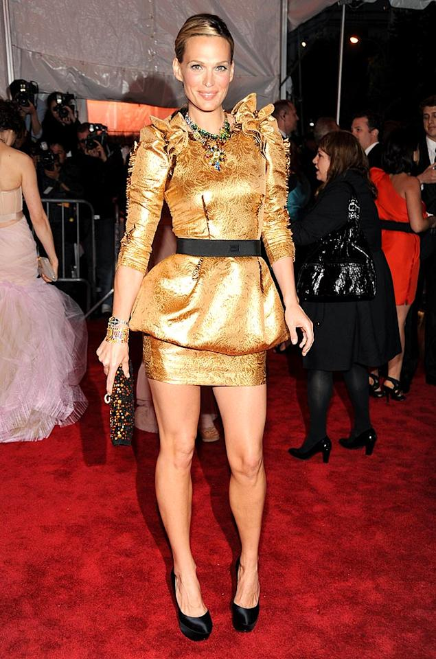 """It's kinda gaudy, but Molly Sims somehow found a way to make her metallic Dolce & Gabbana mini work. Kevin Mazur/<a href=""""http://www.wireimage.com"""" target=""""new"""">WireImage.com</a> - May 4, 2009"""