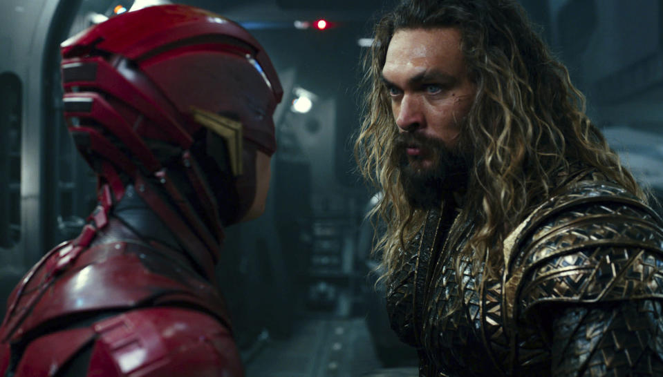 "This image released by Warner Bros. Pictures shows Ezra Miller, left, and Jason Momoa in a scene from ""Justice League."" (Warner Bros. Entertainment Inc. via AP)"