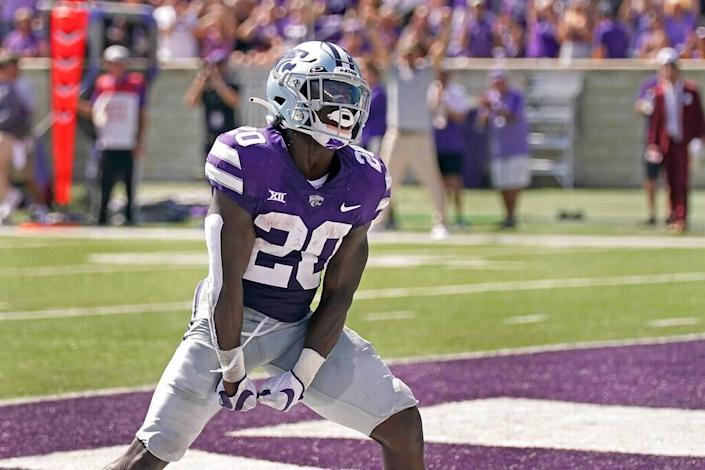 Kansas State running back Joe Ervin (20) celebrates after scoring a touchdown during the first half of an NCAA college football game against Nevada Saturday, Sept. 18, 2021, in Manhattan, Kan. (AP Photo/Charlie Riedel)