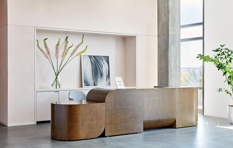 Rapt Studio's custom reception desk echoes the rounded forms of the Goop logo.