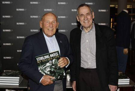 FILE PHOTO - Formula One - F1 - Sir Stirling Moss Book Signing - Selfridges, London - 27/5/15 Sir Stirling Moss poses with author Simon Taylor before the signing Mandatory Credit: Action Images / Tom Jacobs Livepic