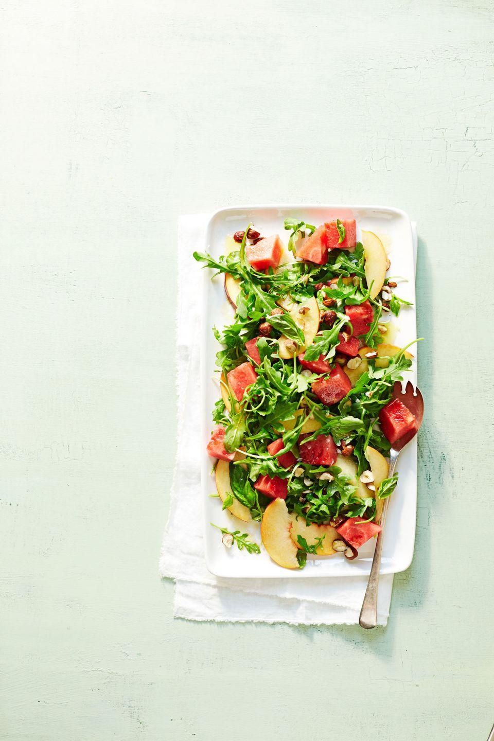 """<p>With a super simple dressing —just olive oil, salt, and red wine vinegar—the best-of-summer produce r<em>eally </em>shines. (Oh hello, watermelon, peaches and basil! ) </p><p><em><a href=""""https://www.goodhousekeeping.com/food-recipes/g1157/watermelon-recipes/?slide=3"""" rel=""""nofollow noopener"""" target=""""_blank"""" data-ylk=""""slk:Get the recipe for Watermelon-Arugula Salad »"""" class=""""link rapid-noclick-resp"""">Get the recipe for Watermelon-Arugula Salad »</a></em></p>"""