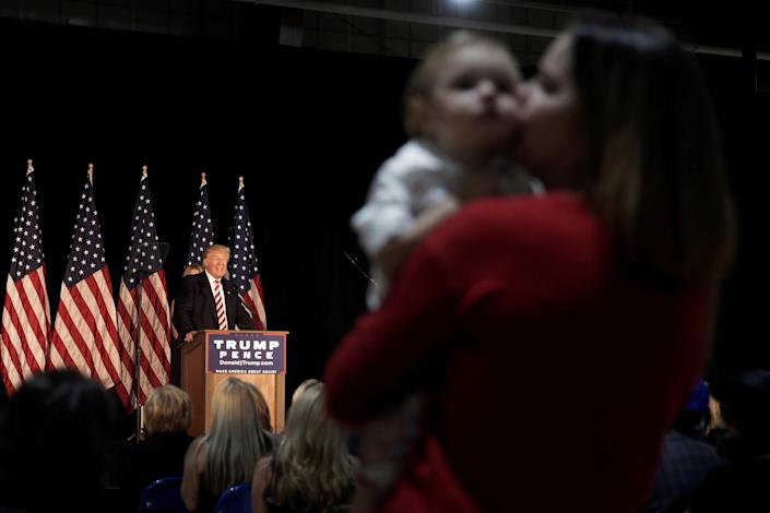 A woman kisses her son while standing in the audience as Republican presidential nominee Donald Trump speaks at a campaign event in Aston, Pa., on Sept. 13. (Photo: Mike Segar/Reuters)