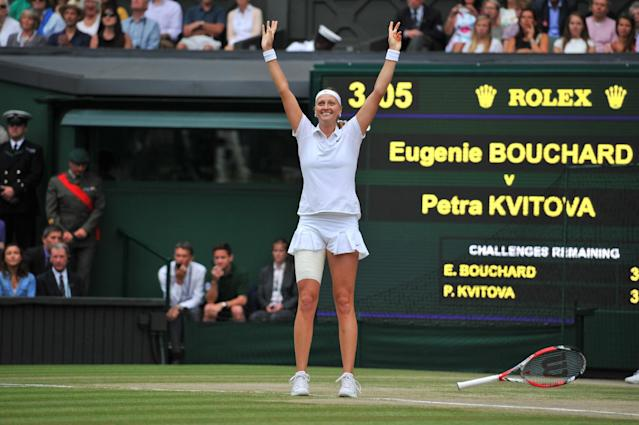 Czech Republic's Petra Kvitova celebrates after beating Canada's Eugenie Bouchard in the women's singles final on day twelve of the Wimbledon Championships at The All England Tennis Club in southwest London, on July 5, 2014 (AFP Photo/Glyn Kirk)