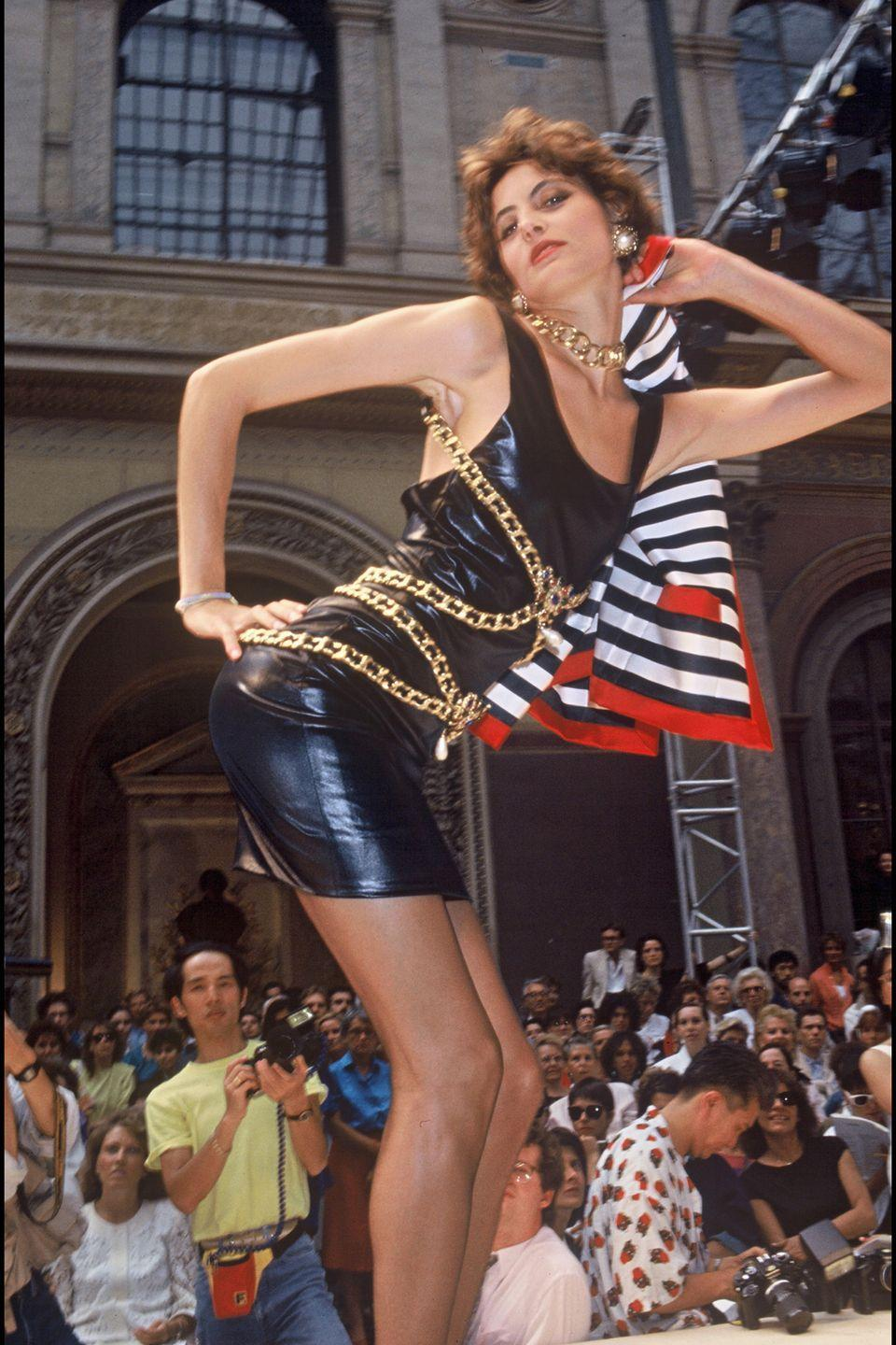 <p>Ines De La Fressange in a chained little black dress on the Chanel runway in Paris. </p>