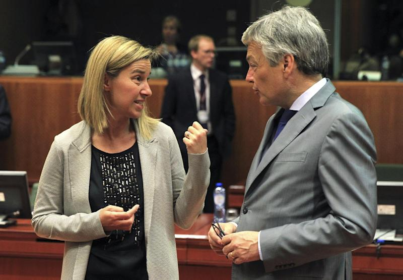 Italy's Foreign Minister Federica Mogherini, left, talks with Belgium's Foreign Minister Didier Reynders during an EU foreign ministers meeting at the European Council building in Brussels Monday, May 12, 2014. EU foreign ministers discuss the situation in Ukraine. (AP Photo/Yves Logghe)