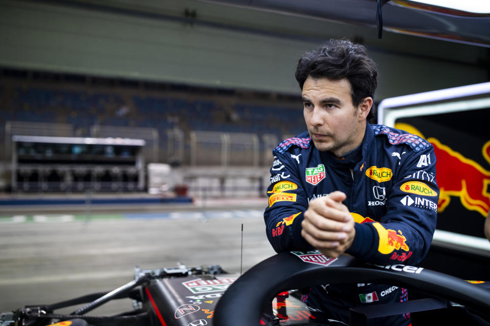BAHRAIN, BAHRAIN - MARCH 25: Sergio Perez of Mexico and Red Bull Racing looks on in the garage during previews ahead of the F1 Grand Prix of Bahrain at Bahrain International Circuit on March 25, 2021 in Bahrain, Bahrain. (Photo by Mark Thompson/Getty Images)