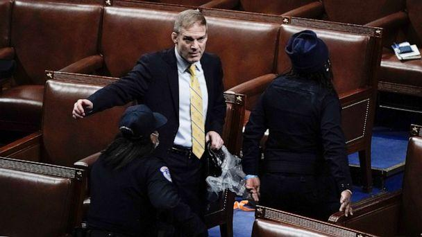 PHOTO: Rep. Jim Jordan, R-Ohio, prepares to evacuate the floor as rioters try to break into the House Chamber at the Capitol, Jan. 6, 2021. (J. Scott Applewhite/AP)