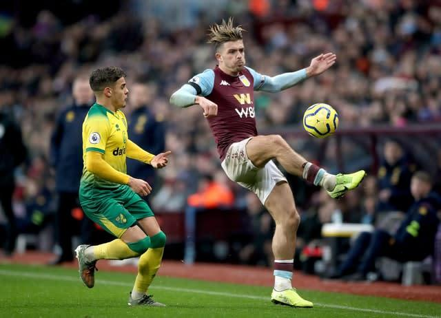 Villa's Jack Grealish (right) and Norwich's Max Aarons (left) battle for the ball during the Premier League match at Villa Park.