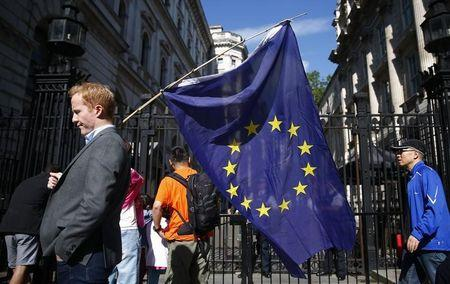 A man carries a EU flag, after Britain voted to leave the European Union, outside Downing Street in London