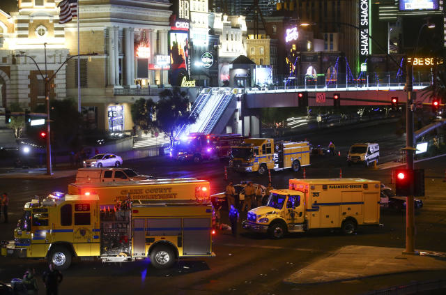 <p>Las Vegas police and emergency vehicles sit on scene following a deadly shooting at a music festival on the Las Vegas Strip early Oct. 2, 2017. (Photo: Chase Stevens/Las Vegas Review-Journal via AP) </p>