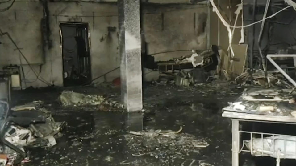 This photo shows inside the Welfare Hospital after a deadly fire in Bharuch, western India, Saturday, May 1, 2021. The fire in a COVID-19 ward of the hospital killed multiple patients early Saturday, as the country grappling with the worst outbreak yet steps up a vaccination drive for all its adults even though some states say don't have enough jabs. (KK PRODUCTIONS via AP)