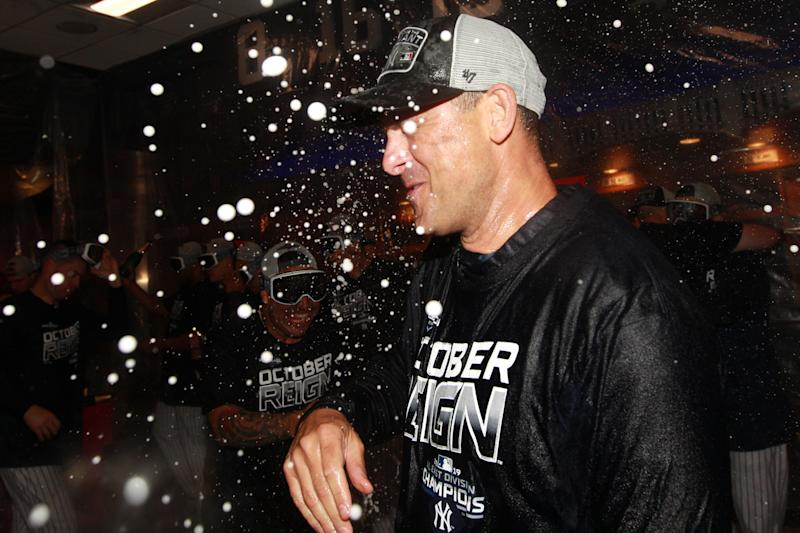 Sep 19, 2019; Bronx, NY, USA; New York Yankees manager Aaron Boone is sprayed with champagne as he celebrates after winning the American League East after defeating the Los Angeles Angels at Yankee Stadium. Mandatory Credit: Brad Penner-USA TODAY Sports