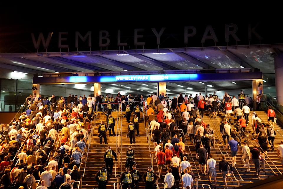 England fans outside Wembley Park station after the Uefa Euro 2020 final defeat (Zac Goodwin/PA) (PA Wire)