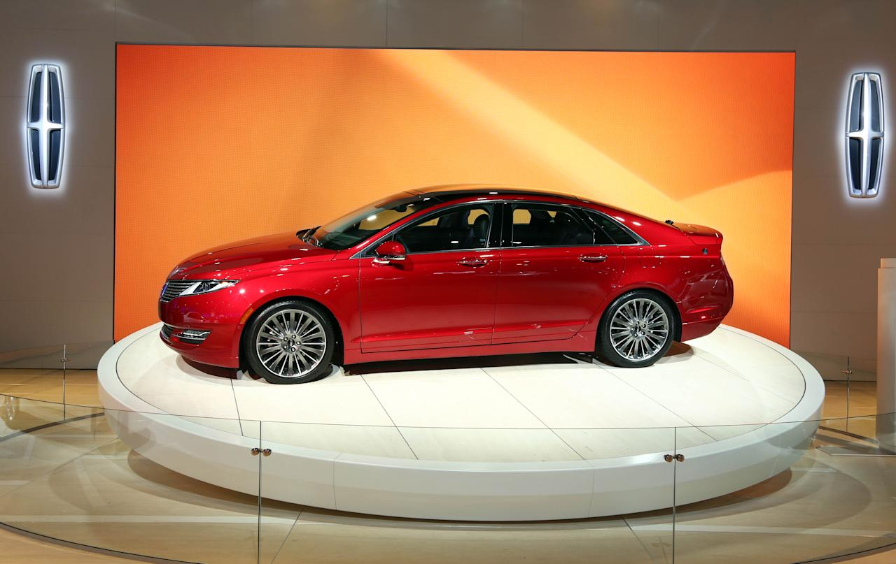 The All-New 2013 Lincoln MKZ and MKZ Hybrid display is seen during the Los Angeles Auto Show press day, Thursday, Nov. 29, 2012 in Los Angeles. (Photo by Matt Sayles/Invision for Lincoln/AP Images)