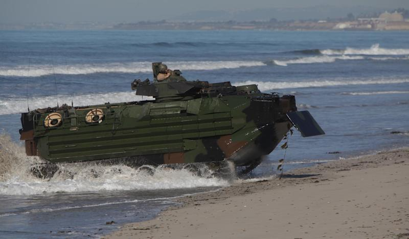 This image provided by the U.S. Marine Corps shows Marines from the 13th Marine Expeditionary Unit landing their amphibious assault vehicle Feb. 13, 2013 at Camp Pendleton, Calif. during Exercise Iron Fist.  (AP Photo/U.S. Marine Corps, Sgt. Christopher O'Quin)
