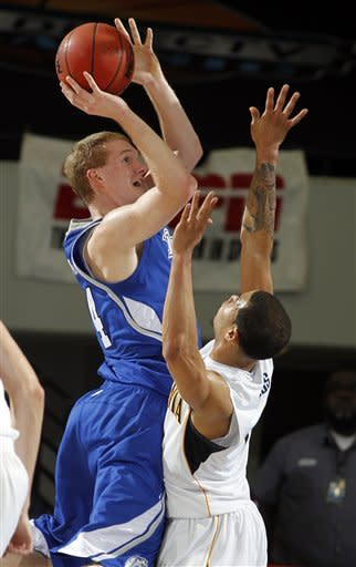 Drake forward Ben Simons, left, shoots over California guard Justin Cobbs (1) during the first half of their NCAA college basketball game in the first round of the DirecTV Classic in Anaheim, Calif., Thursday, Nov. 22, 2012. (AP Photo/Alex Gallardo)