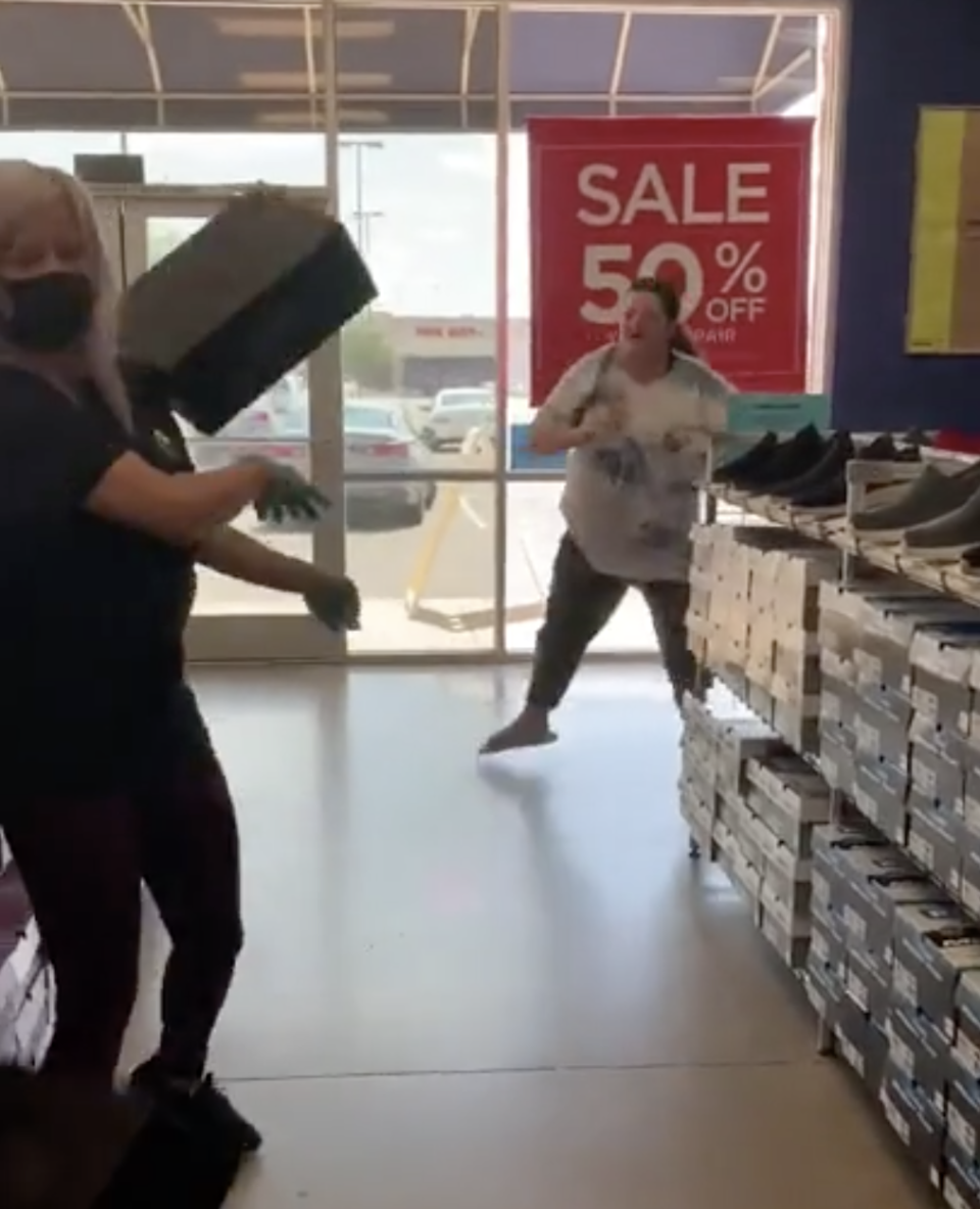 A video still of a shoebox hitting the Skechers worker on the shoulder.
